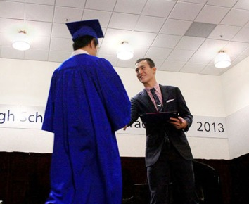 Olympic figure skater Patrick Chan hands a Bodwell High School and Academy student a scholarship at their recent graduation ceremony. Photo: Ley Doctor