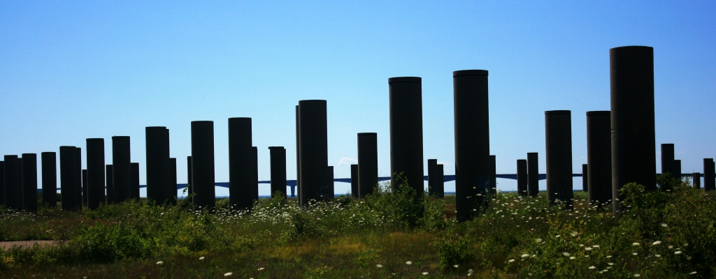Behind the pillars where spans were constructed, you can see Confederation Bridge.